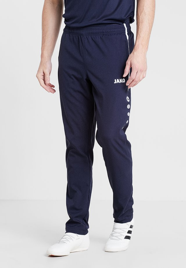 STRIKER - Tracksuit bottoms - marine/weiß