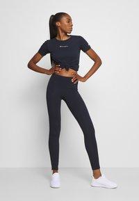 Champion - CREWNECK LEGACY - Print T-shirt - dark blue - 1