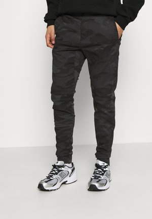 JOGGER - Trousers - black camo stacked skinny jogger
