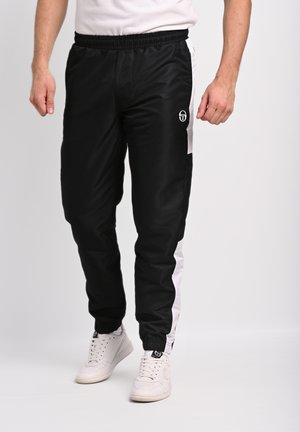 ABITA - Tracksuit bottoms - anthracite/ blanc