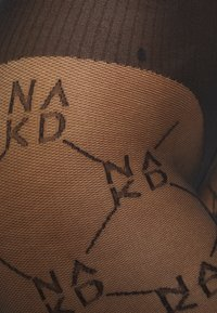 Hunkemöller - x NA-KD TIGHT - Panty - black - 2