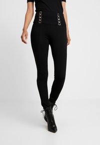 Guess - FERAH - Leggings - Trousers - jet black - 0