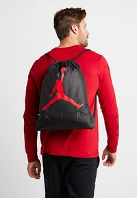 Jordan - AIR GYM SACK - Mochila de deporte - black - 1