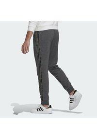 adidas Performance - COMOUFLAGE PT ESSENTIALS SPORTS REGULAR PANTS - Tracksuit bottoms - grey - 1