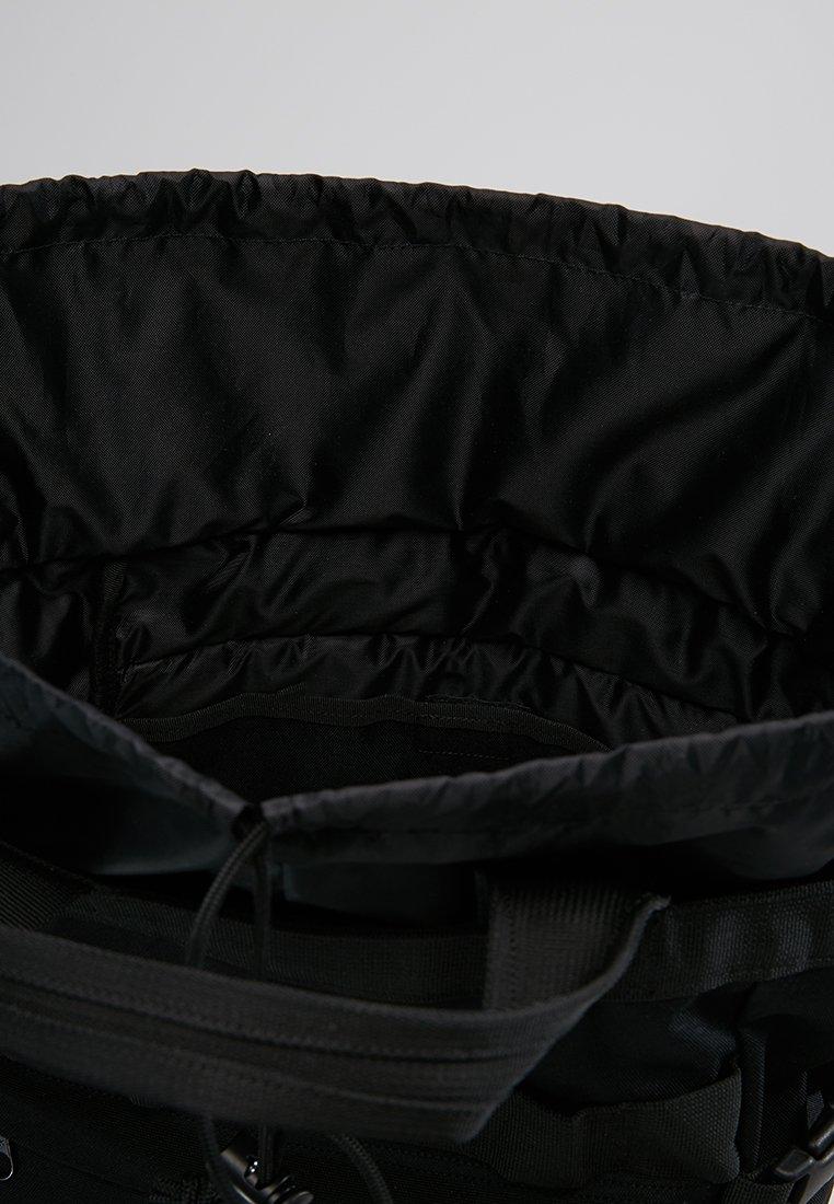Carhartt WIP PAYTON CARRIER BACKPACK - Ryggsekk - black/white/svart UOzmzeTTZzDTtNJ