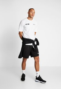 Puma - TEE - Print T-shirt - puma white - 1