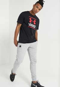 Under Armour - FOUNDATION - Print T-shirt - black/white/red - 1