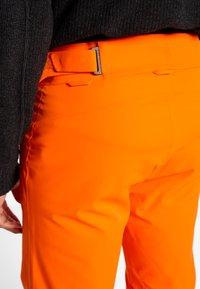 Kjus - MEN FORMULA PANTS - Snow pants - orange - 4