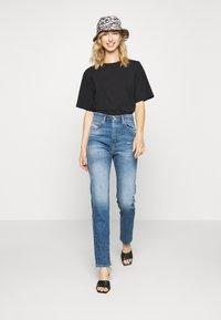 Diesel - D-EISELLE - Slim fit jeans - indigo - 1