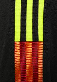 adidas Performance - TIRO - Chaqueta de entrenamiento - black/red - 2