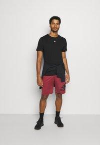 Tommy Hilfiger - LOGO TEE - Sports shirt - black - 1