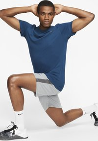 Nike Performance - DRY TEE CREW SOLID - Basic T-shirt - blue - 1