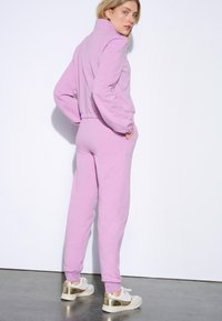 ORSAY - Tracksuit bottoms - lilac - 2