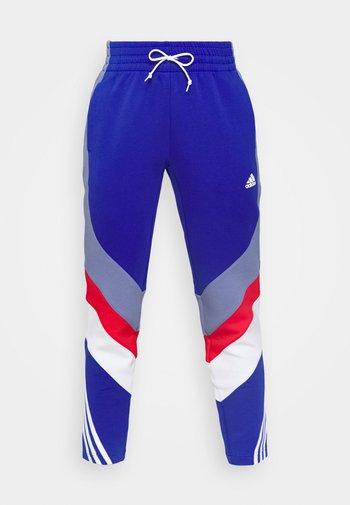 PANTS - Tracksuit bottoms - bold blue