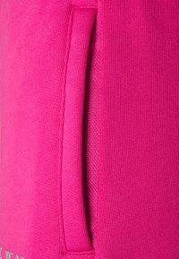 Versace Jeans Couture - PANTS - Tracksuit bottoms - pink - 5