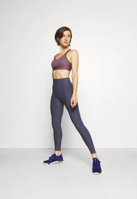 Under Armour - INFINITY MID BRA - Medium support sports bra - purple/black - 1