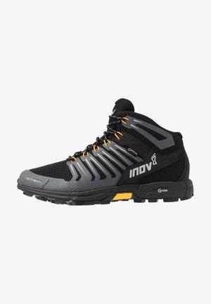 ROCLITE 345 GTX - Hiking shoes - black/yellow