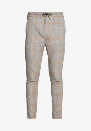 ADAM - Trousers - brown/orange