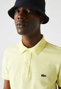 Lacoste - Polo shirt - jaune - 2