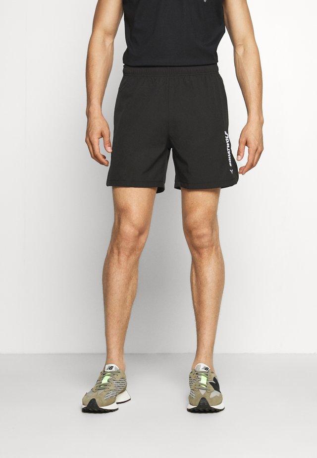 WARRIOR SHORTS - Sports shorts - black