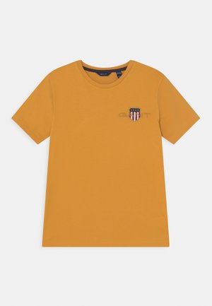 ARCHIVE SHIELD UNISEX - T-shirt con stampa - ivy gold