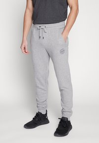 Jack & Jones - JJIGORDON  - Träningsbyxor - light grey melange - 0