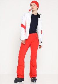 Kjus - WOMEN FORMULA PANTS - Snow pants - fiery red - 1