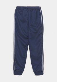 Nike Sportswear - REPEAT - Træningsbukser - midnight navy/white - 1