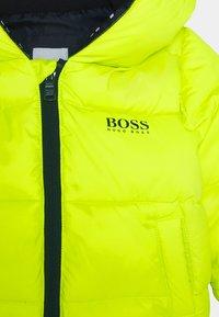 BOSS Kidswear - PUFFER JACKET BABY  - Winter jacket - green lemon - 2