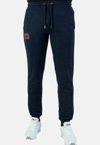 Russell Athletic - Pantalon de survêtement - blue - 0