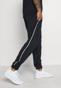 Tommy Hilfiger - PIPING TRACKSUIT CUFFED PANT - Pantaloni sportivi - blue - 3