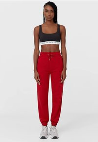 Stradivarius - Tracksuit bottoms - red - 1