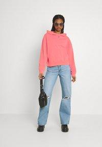 Nike Sportswear - WASH HOODIE - Sweatshirt - sunset pulse/black - 1