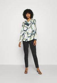 Monki - ASSA BLOUSE - Button-down blouse - khaki green/dusty light khakiart - 1