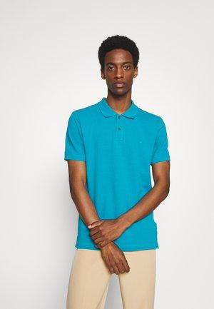 PABLO - Polo shirt - caneel bay
