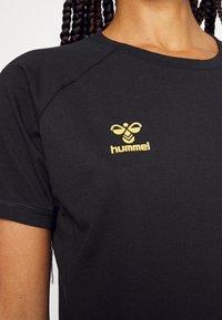 Hummel - CIMA XK WOMAN - Print T-shirt - black - 4