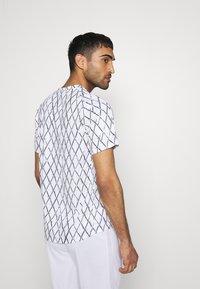 Nike Performance - Print T-shirt - white/black - 2