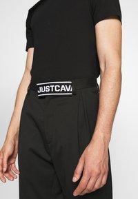 Just Cavalli - PANTALONE - Trousers - black - 3