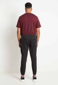 Jack & Jones - JJIVEGA JJJOGGER - Trousers - black - 3