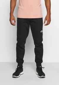 The North Face - MEDIUM - Tracksuit bottoms - black - 0