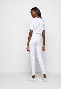 Love Moschino - Pantalon de survêtement - white - 2