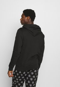 Calvin Klein Underwear - ONE RAW EDGE HOODIE - Maglia del pigiama - black - 2
