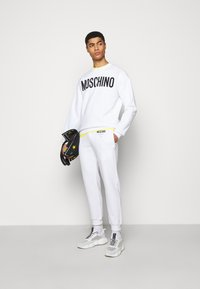 MOSCHINO - TROUSERS - Tracksuit bottoms - white - 1