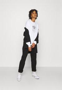 Carhartt WIP - TAB - Long sleeved top - white/black - 1