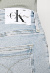 Calvin Klein Jeans - HIGH RISE ANKLE - Jeans Skinny Fit - blue - 3