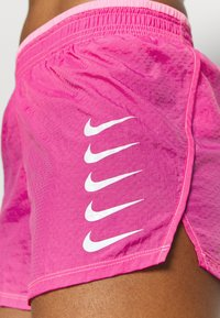 Nike Performance - RUN SHORT - Pantalón corto de deporte - pink glow/white - 4