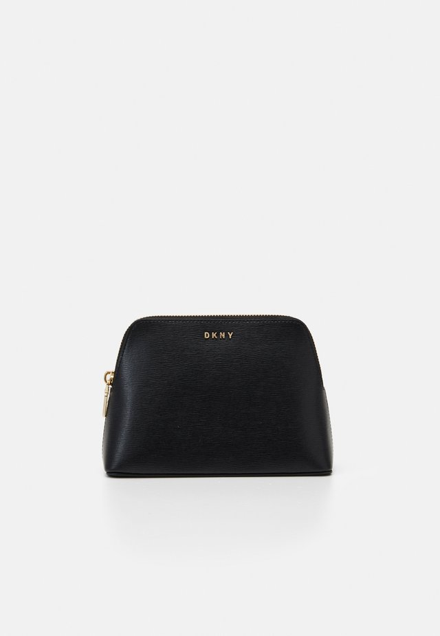 BRYANT COSMETIC CASE - Wash bag - black/gold