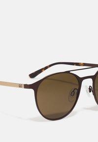 Calvin Klein - UNISEX - Sunglasses - dark brown - 3