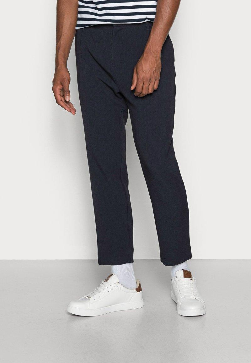 Weekday - MARD TROUSERS - Trousers - blue melange