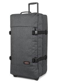 Eastpak - TRANVERZ L CORE COLORS - Wheeled suitcase - black denim - 3